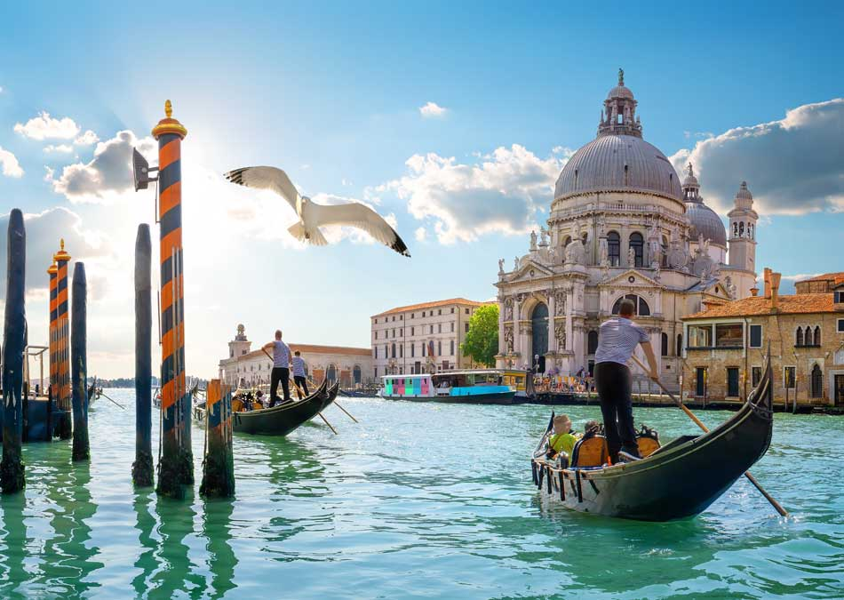 Gondolas along the Gand Canal in Venice, Italy