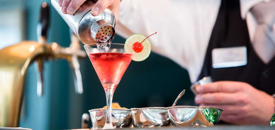 Get a drink from the master mixologists at Castillo Bar