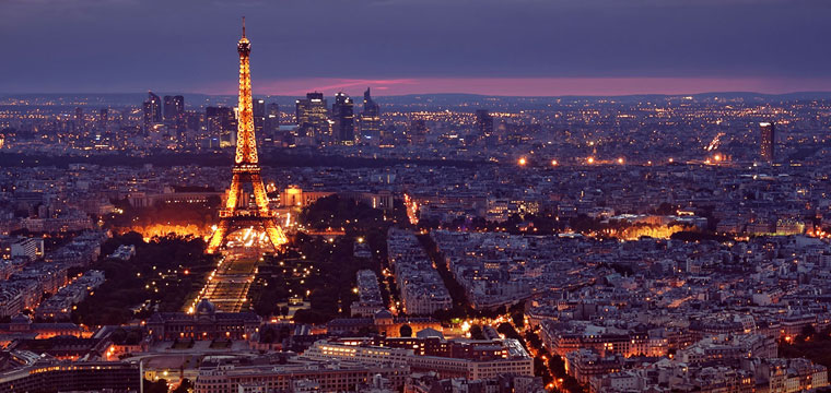 Paris and the Eiffel Tower lit up at night