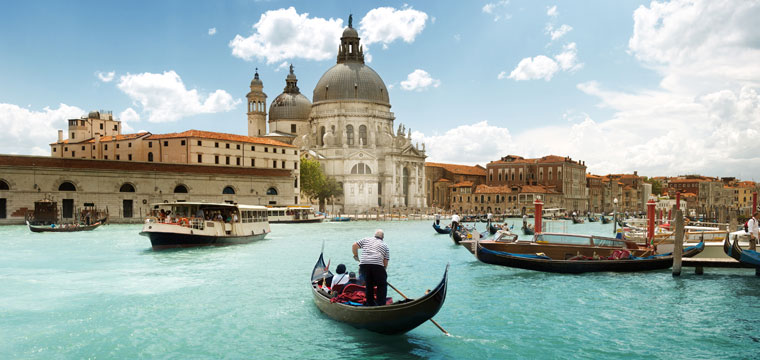 Take in the beautiful sights of Italy by boat