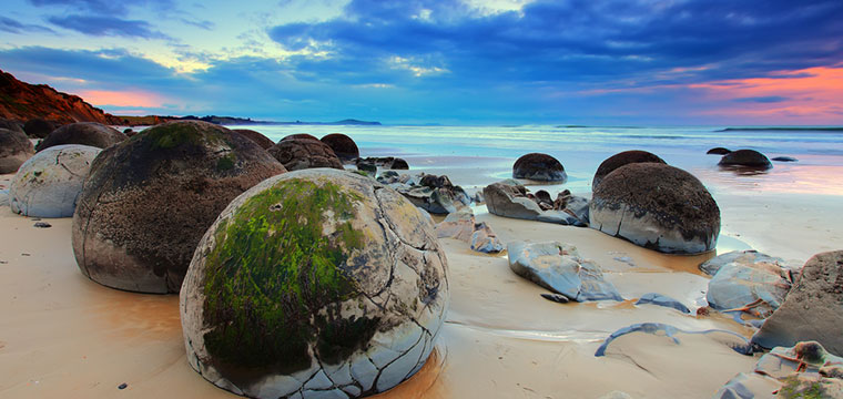 A popular place to visit is the Moeraki Boulders in New Zealand