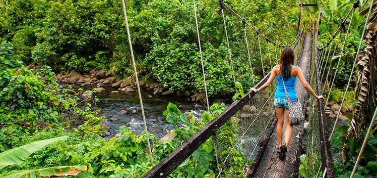 Crossing Wainibau stream on Taveuni Island in Fiji