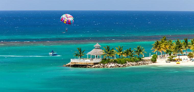 Para sailing over the tropical island of Ocho Rios, Jamaica