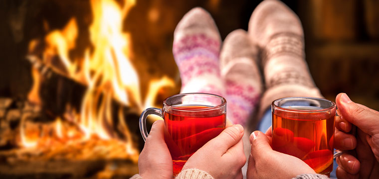 Relax by the fire after a long day in the snow